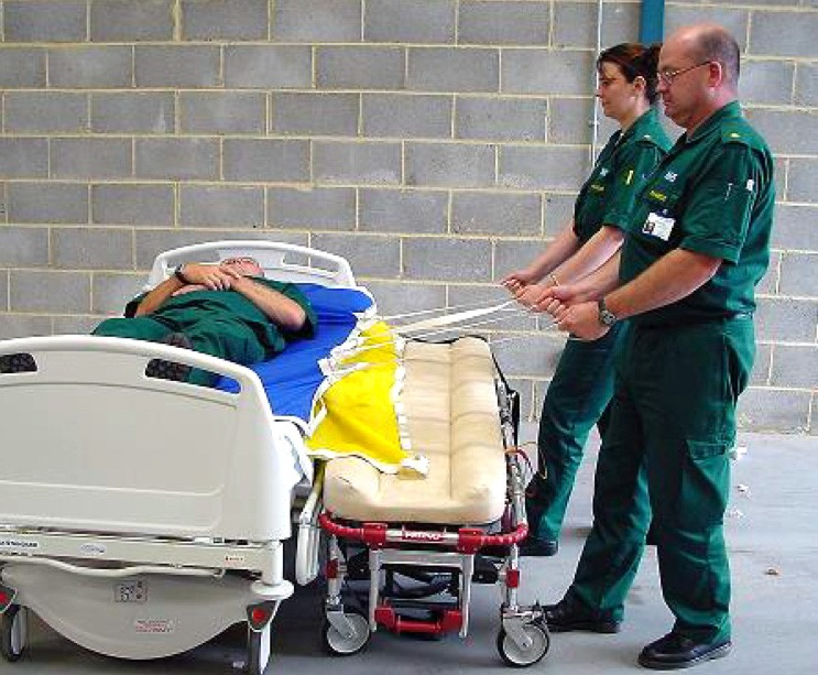 moving and handling equipment being used to transport a patient.